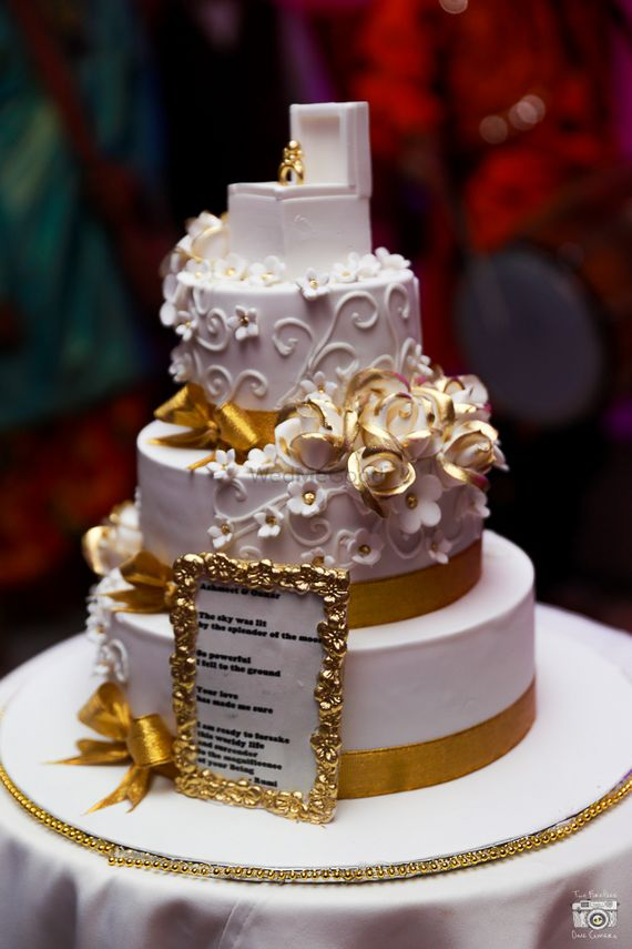 Photo of white and gold cake