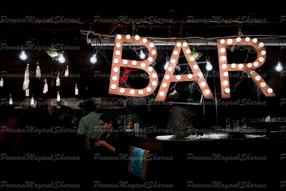 Photo of Hanging bar sign with bulbs