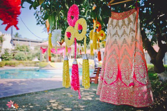 Photo of Orange and pink ombre lehenga on hanger