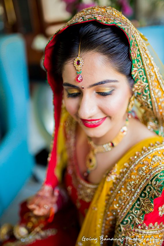 Photo of Makeup with yellow and red lehenga with dupatta