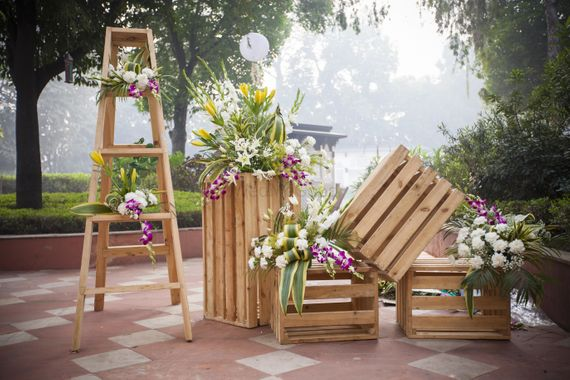 Photo of Backyard wedding decor with rustic setting using wooden crates