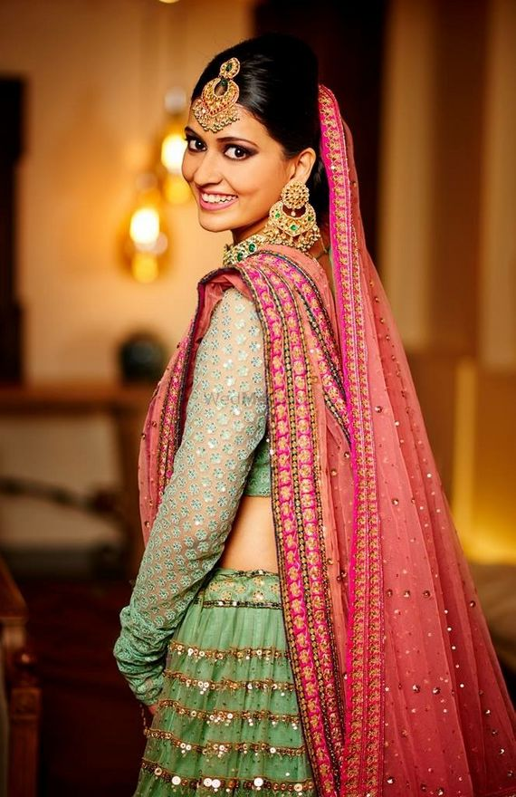 Photo of Unique green and bridal lehenga with red dupatta