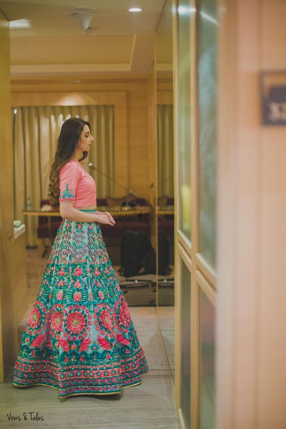 Photo of Green and pink quirky threadwork lehenga