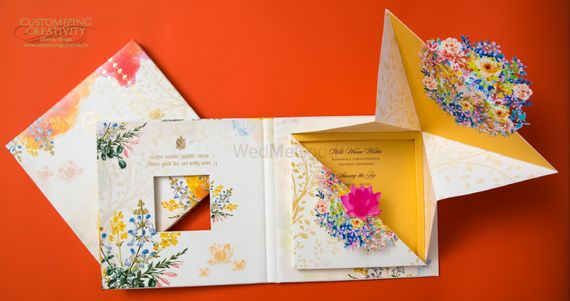 Photo of Bright and vibrant floral wedding card