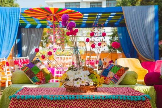 Photo of Floral basket with pom pom sticks in table setting