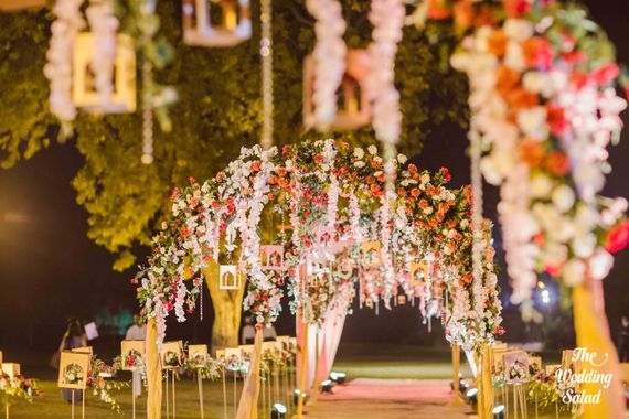 Photo of Beautiful hanging floral arrangements in night decor