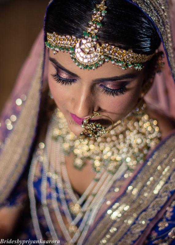 Photo of Bride with pink smokey metallic eye makeup