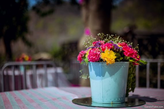 Photo of Centrepiece idea with flowers in bucket