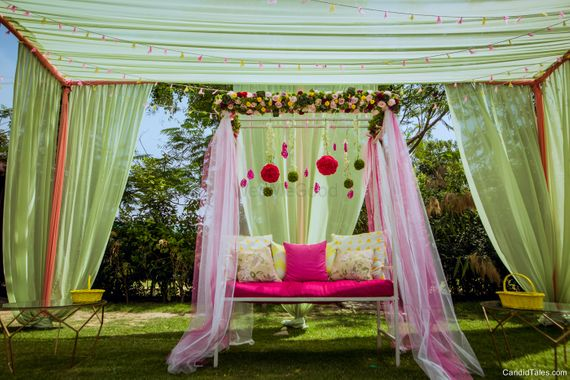 Photo of Mehendi swing with green and pink decor