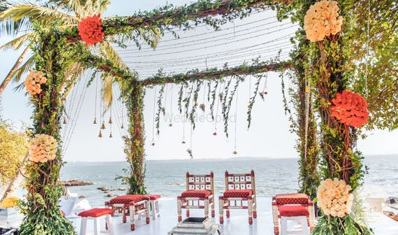 Photo of Beautiful beach side mandap done in greenery and colourful flowers