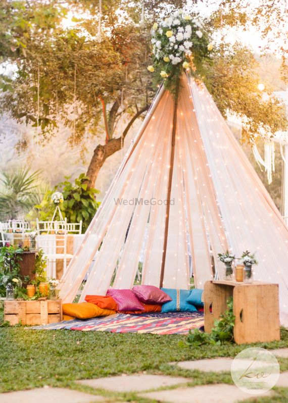 Photo of Beautiful outdoor tents with fairy lights and colourful pillows