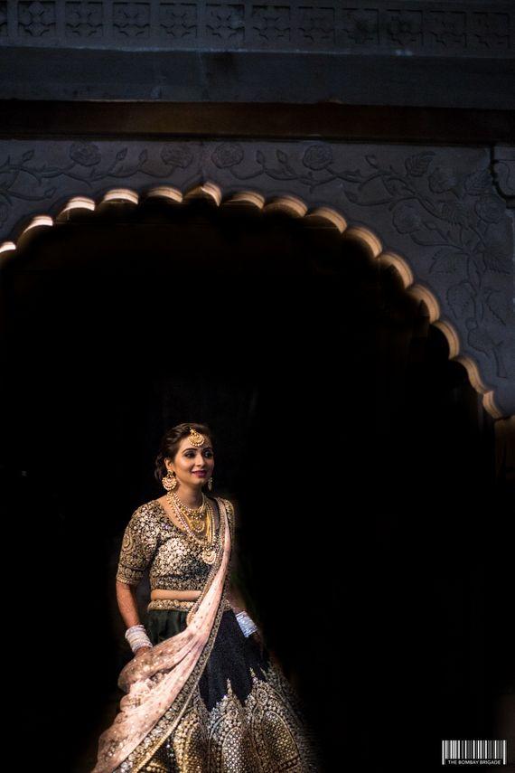 Photo of Black and gold shimmery lehenga for sangeet