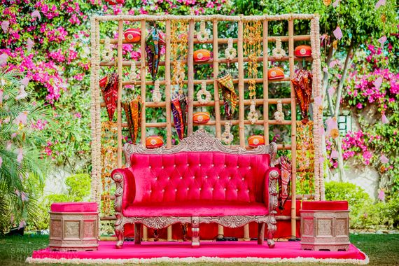 Photo of Bright and colorful mehendi stage decor