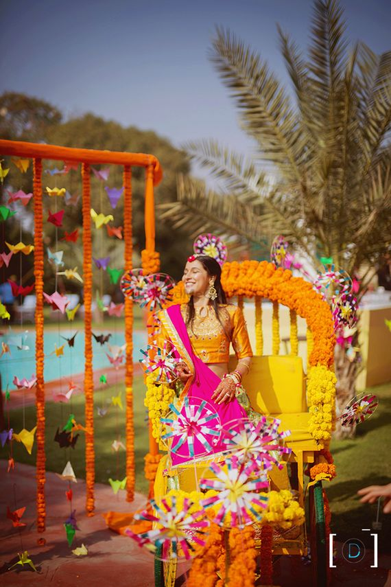 Photo of Bride entering on a decorated rickshaw