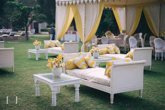 Photo of Yellow and white classy mehendi decor with unique tents