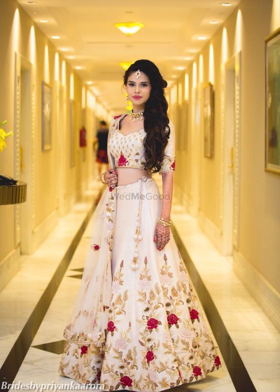 Photo of Ivory engagement lehenga with floral embroidery