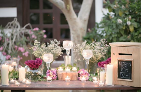 Photo of Candle lit and floral decor with personalized elements