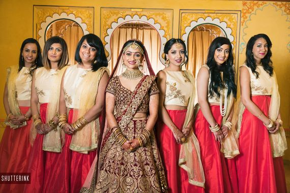 Photo of Bride with color coordinated bridesmaids