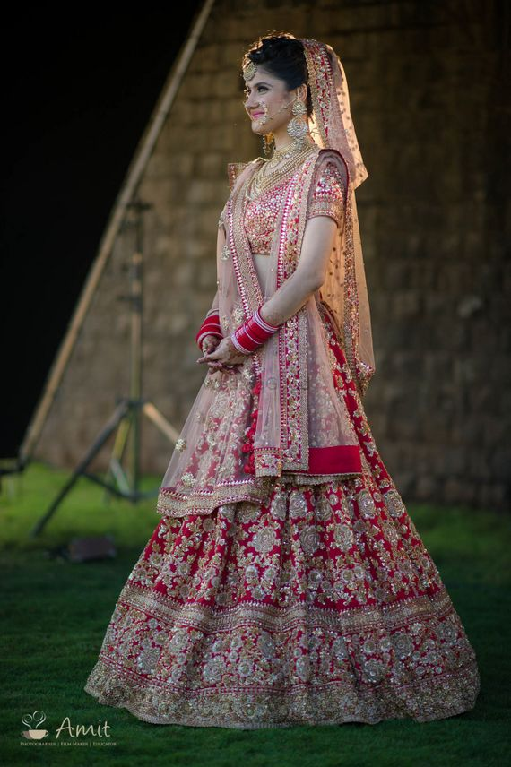 Photo of Light and dark red bridal lehenga