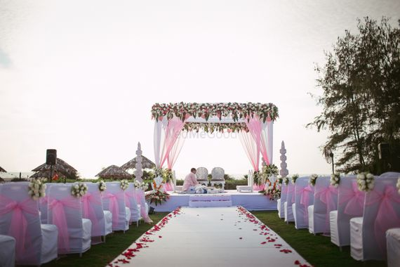 Photo of white and pink chairs