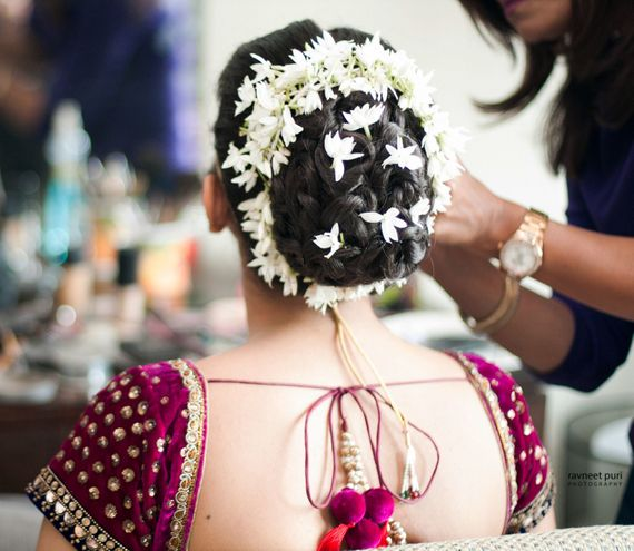 Photo of Bridal bun with white flowers and gajra