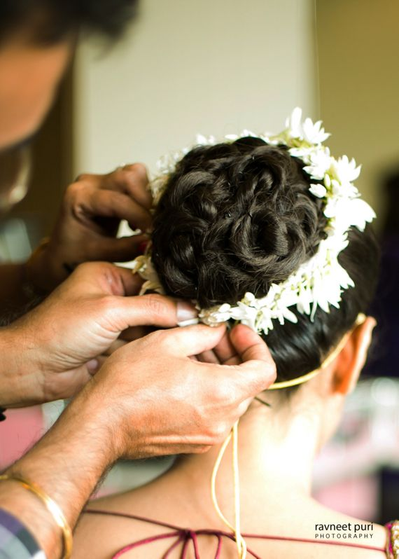 Photo of Bridal bun with braid and white flowers