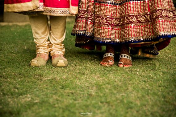 Photo of Couple feet shot with bride and grooms feet