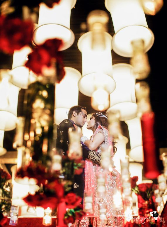 Photo of Romantic couple shot with foreground