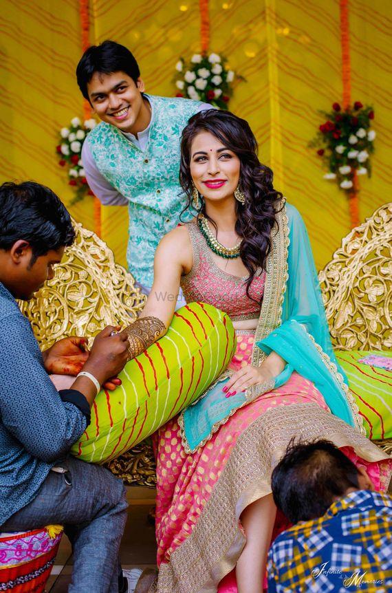 Photo of Bride while getting mehendi put