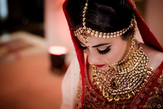 Photo of Bridal portrait in statement bridal jewellery