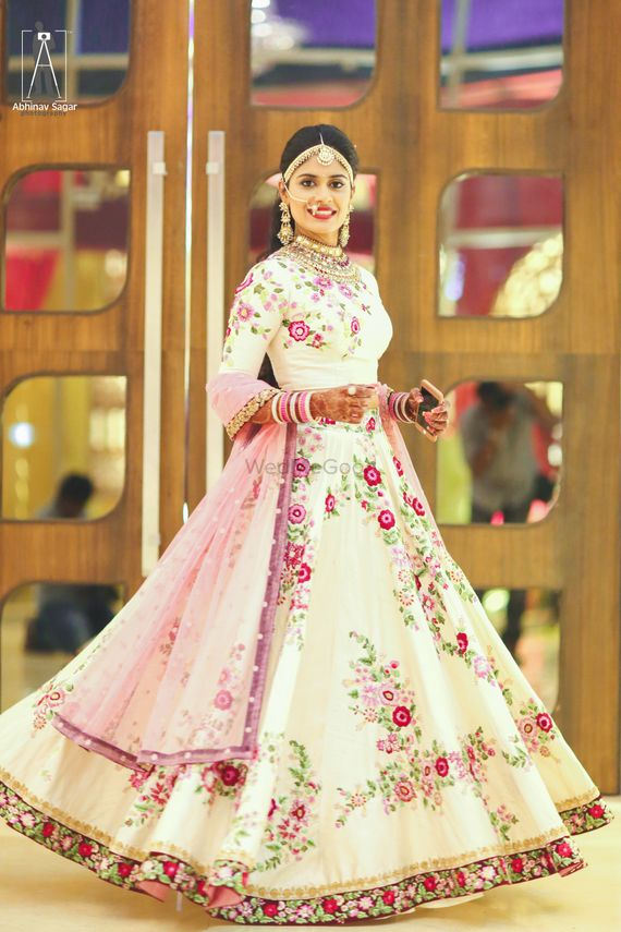 Photo of Engagement Anarkali with floral print on white