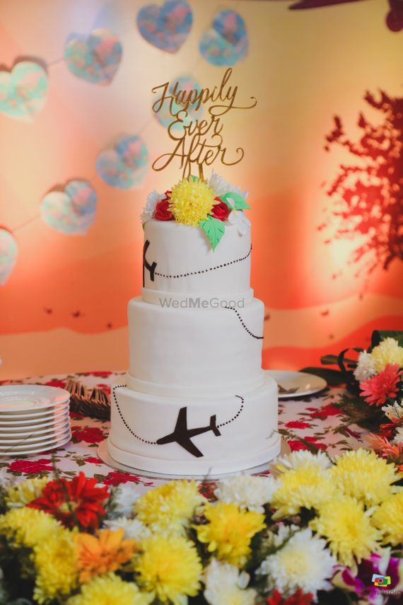Photo of Theme wedding cake with topper