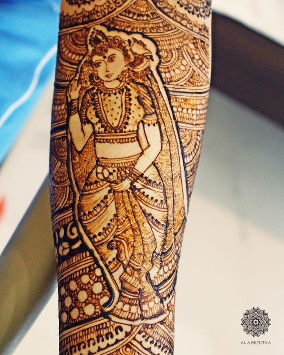 Photo of Bridal mehendi design with god idol