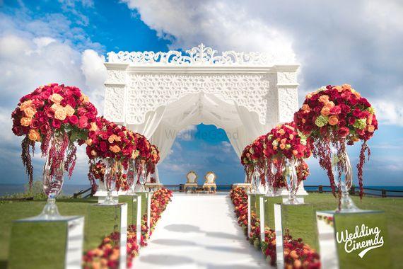 Photo of Destination wedding mandap with floral aisle