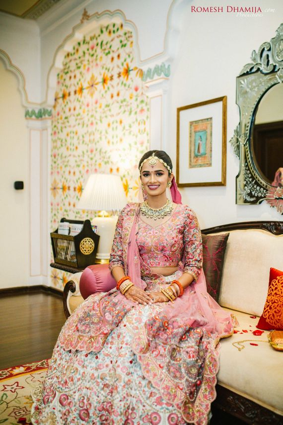 Photo of Pink bridal lehenga with floral embroidery all over