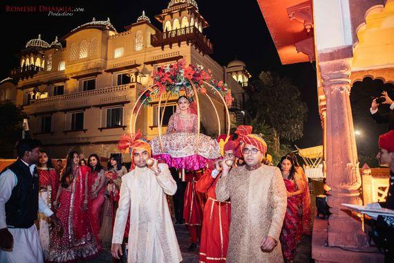 Photo of Bride entering in palki shot