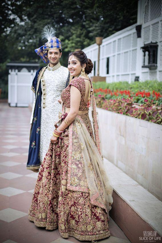 Photo of Maroon and gold bridal lehenga with zardozdi work