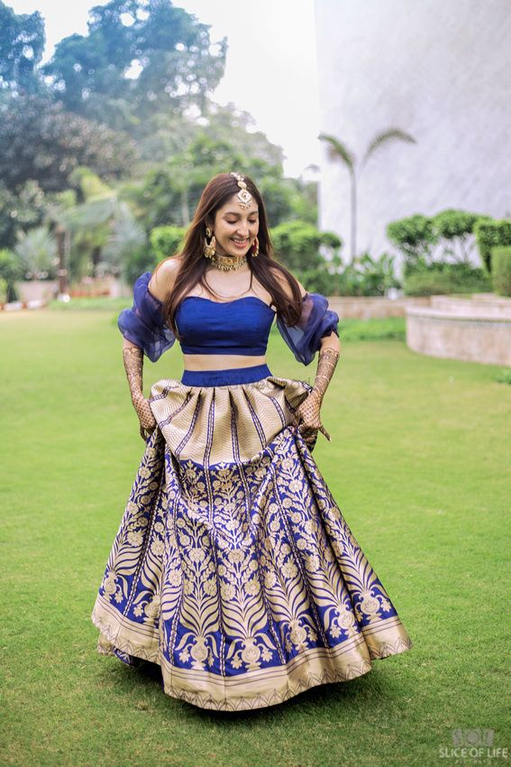 Photo of Unique blue and gold off shoulder blouse design for mehendi
