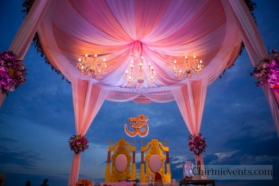 Photo of Bright and light pink mandap with chandeliers