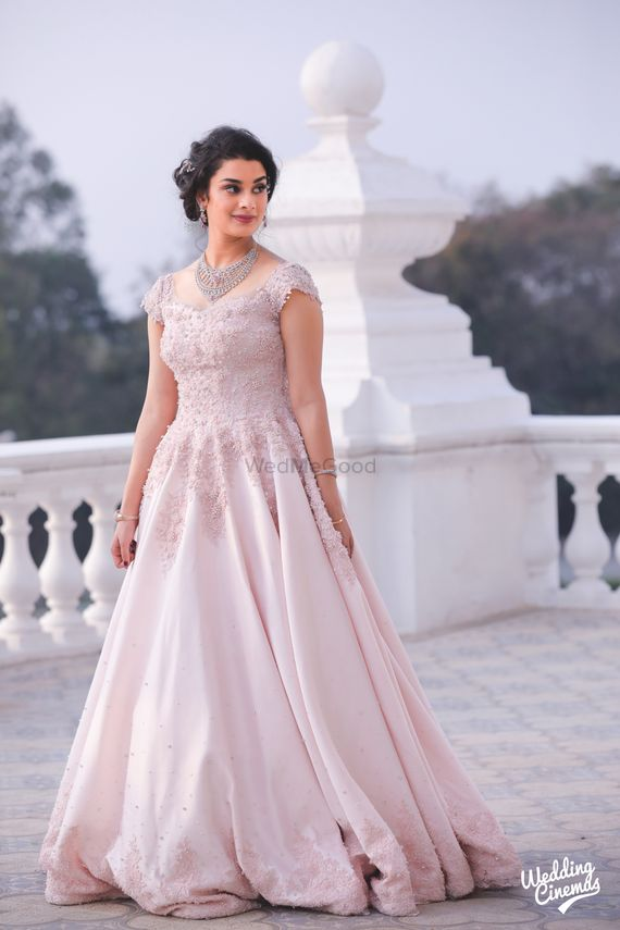 Photo of Light pink embellished engagement gown