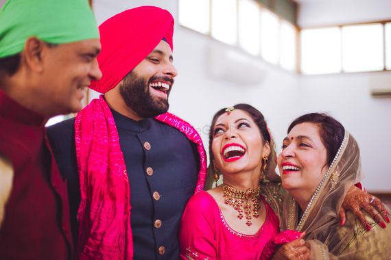 Photo of Adorable family shot with family laughing