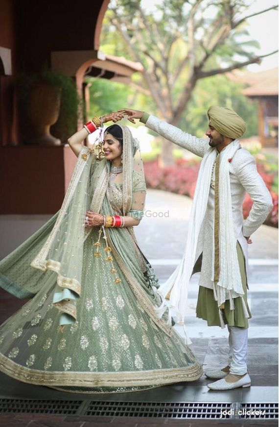 Photo of Offbeat bride and groom outfits in seafoam