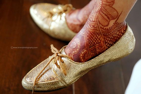 Photo of gold flat shoes