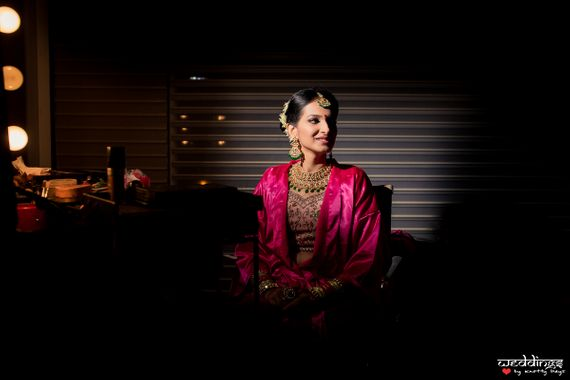 Photo of Bride getting ready shot in the dark