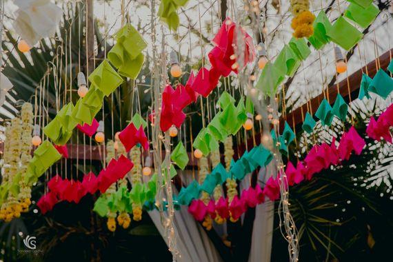 Photo of Mehendi decor idea with hanging origami