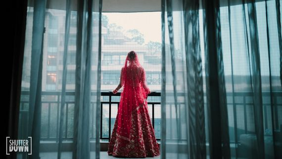Photo of Bridal portrait idea looking out of balcony
