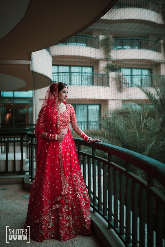 Photo of Red and gold modern bridal lehenga