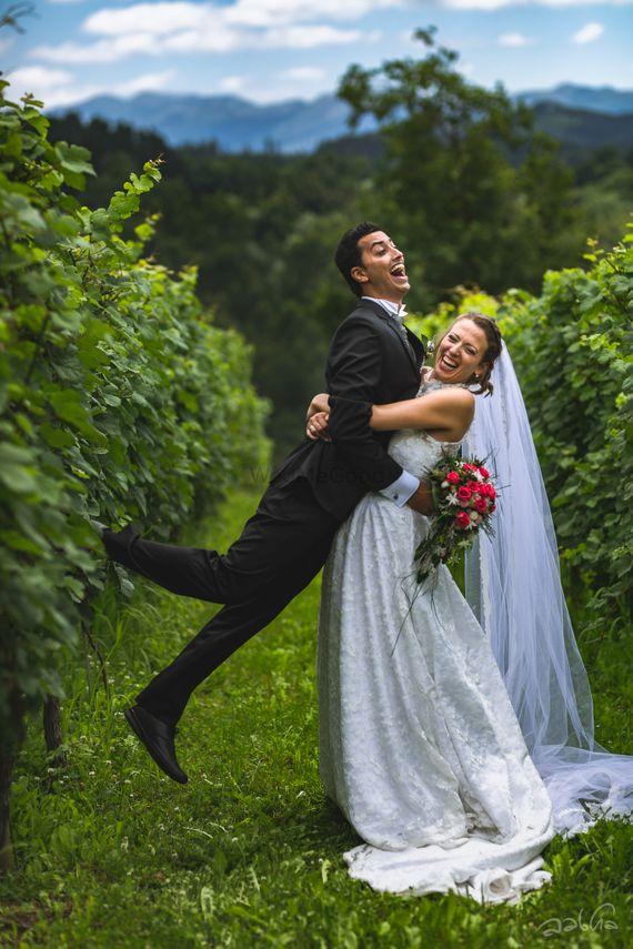 Photo of Amazing vinyard white wedding with a fun couple portrait