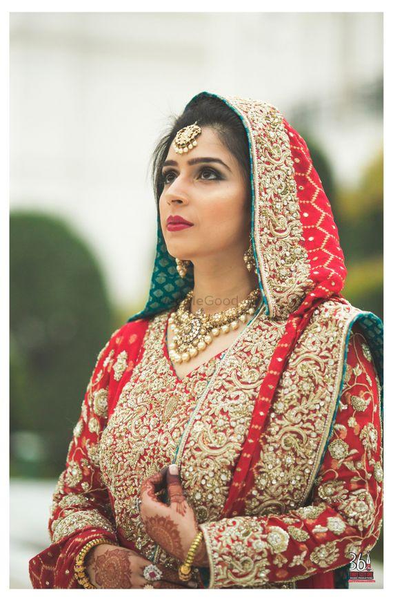 Photo of Pretty bridal red and gold sharara
