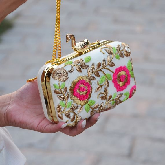 Photo of white pink and green clutch